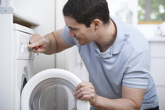 Engineer Mending Domestic Washing Machine