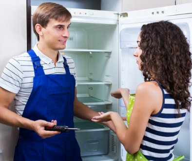 Furious woman standing near fridge